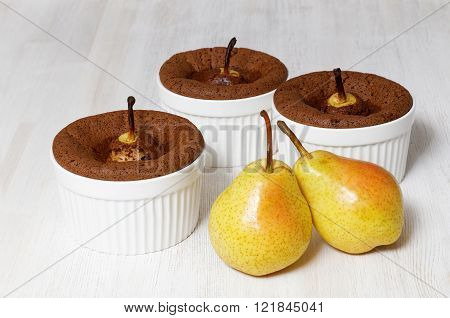 Three Chocolate-almond Muffins With Pears In White Ceramic Baking Dish