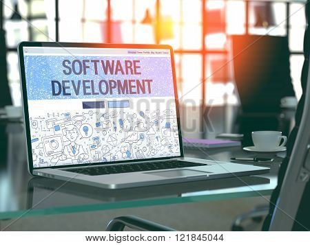 Software Development on Laptop in Modern Workplace Background.