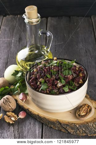 Red Beans With Onions, Garlic, Walnut On A Dark Wooden Background