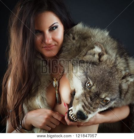 Beautiful girl in the skin of a wild wolf