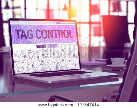 Tag Control on Laptop in Modern Workplace Background.
