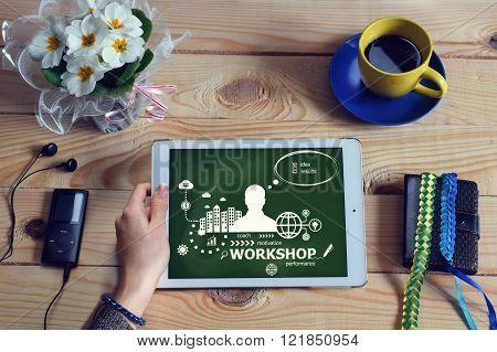 Laptop Computer, Tablet Pc And Workshop Design Concept On Wooden Office Desk