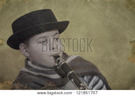 young clarinet player with a hat and scarf