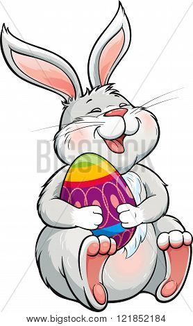 Lovely laughing  bunny holding painted easter egg