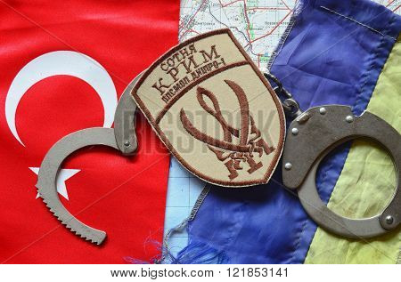 Kiev,Ukraine.FEB 20 Chevron of Islamic extremist formation Crimea.Background map of Kherson Caliphate & Turkey flag on February 20,2016 in Kiev, Ukraine