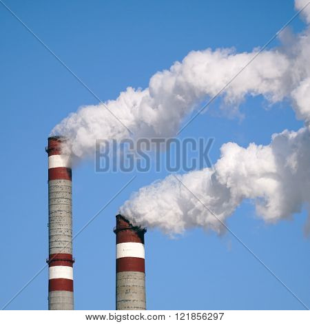 industrial chimneys emits toxic pollutants into the sky polluting environment