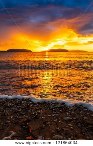 Beautiful colorful sunset on the beach. Tropical paradise resort at the seaside. ** Note: Shallow depth of field