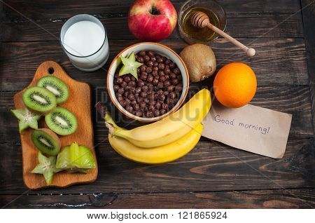 Healthy Breakfast - Cereal Chocolate Balls, Milk And Fruit On Wood Background