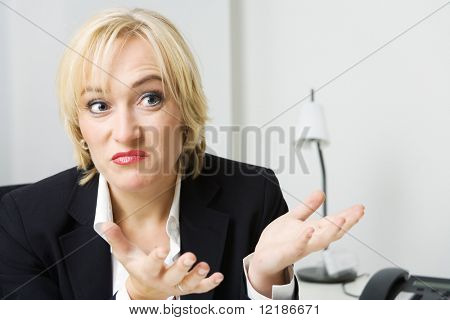 a business woman looking unsure or undecided