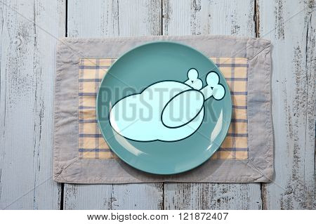 Empty plate with chicken meat sign on light blue wooden background
