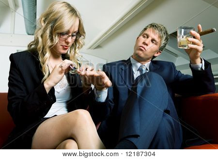 Boss is drinking and smoking while his secretary files his nails