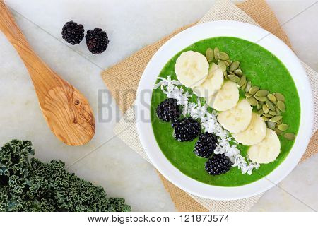 Green Smoothie Bowl With Kale, Fresh Blackberries, Bananas, Pumpkins Seeds, And Coconut. Overhead Sc