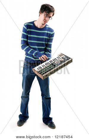 Musician holding a vintage synthesizer in his hand