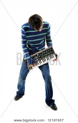 Musician playing his vintage synth like a guitar