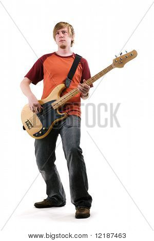 A musician playing a bass guitar, posing