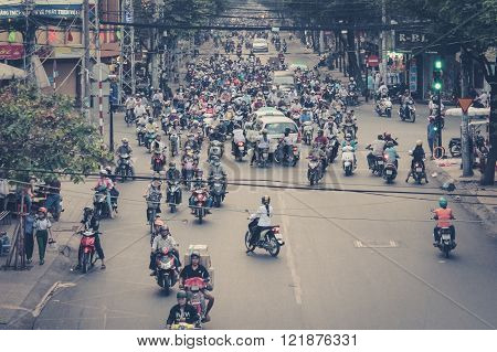 Many Scooter Drivers , Motorbike Traffic , Streets Of Saigon, Vietnam