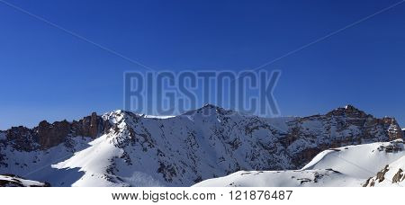 Panoramic View On Snowy Mountains In Morning