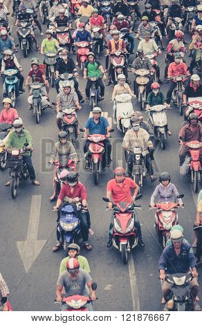 Motorbike Traffic In Saigon - Many Scooter Drivers , Crowded Street