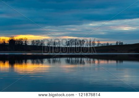 Close Up Of Opposite Shore Of Lake After Sunset