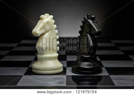Chess. Black and White Knights on the board. Set of chess figures.