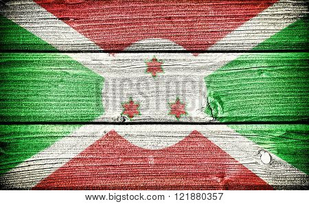 flag of Burundi painted on old grungy wooden background
