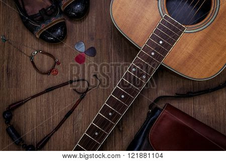 flat lay of the accessories of a female boho guitarist