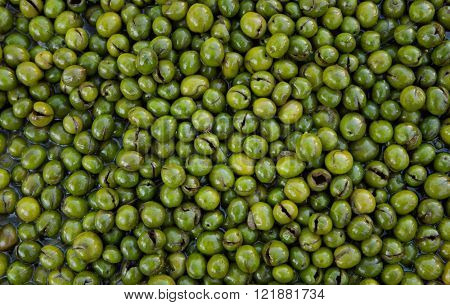 Green olives forming a background