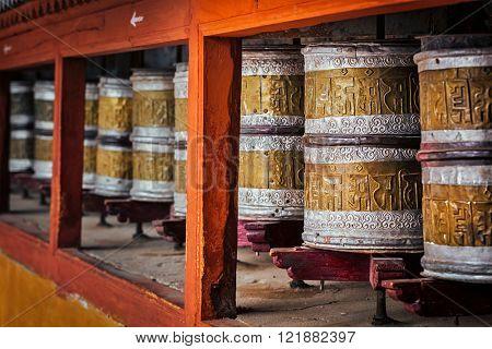 Buddhist prayer wheels in Hemis gompa (Tibetan buddhist monstery). Ladakh, India