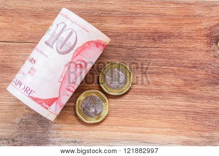 Singapore money on wooden table background, various of singapore dollar banknote