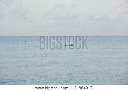 one lonely fisherman boat in sea asian vietnamese style, mui ne