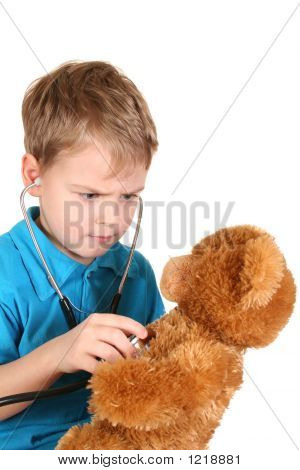 Boy With Stethoscope And Teddy Bear