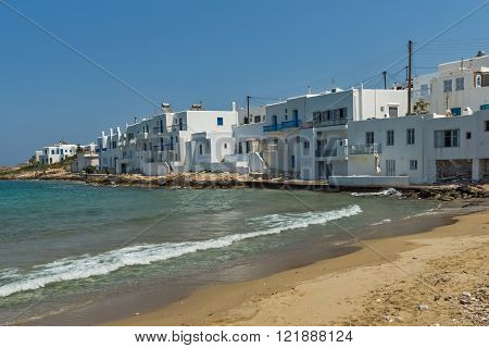 Small beach and white houses in town of Naoussa, Paros island, Cyclades, Greece
