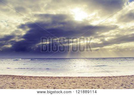ray of sun over the beach at Kauai, Hawaii with cloudy sky
