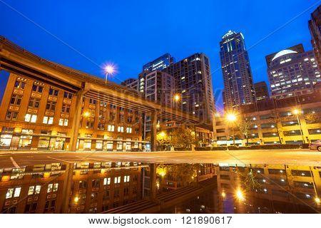 modern buildings near water at night in seattle
