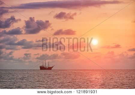 Sail ship in Puerto Vallarta, Mexico, with sunset in the background.