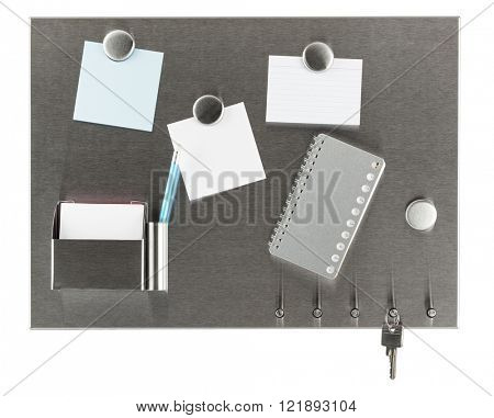 brushed steel magnet pinboard with blank pieces of paper, address book and key