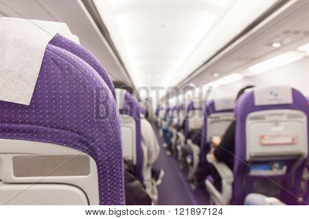 Interior of passenger airplane and aisle on plane