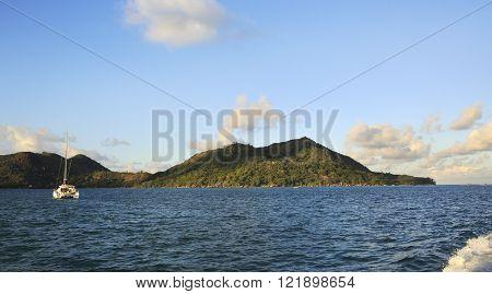 Sea yacht in Indian Ocean on background of island Praslin.