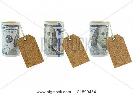 Rolled new United stated 100 dollar banknote with blank natural cork label tags hanging, isolated on white