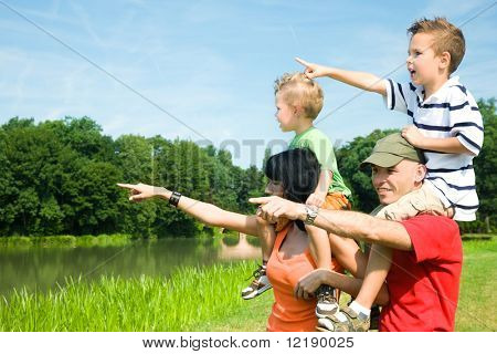 Family with two kids in vacation on a sightseeing trip