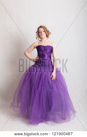 portrait of a woman in a purple evening gown