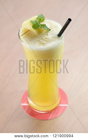 pineapple juice with mint leaf in a tall glass