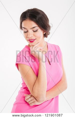 Portrait of cute lovely smiling young woman on pink top over white backgrond