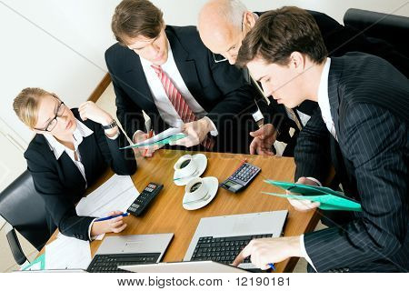 Businesspeople crunching the numbers of a business plan