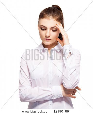 Woman at white background. Young sad female isolated
