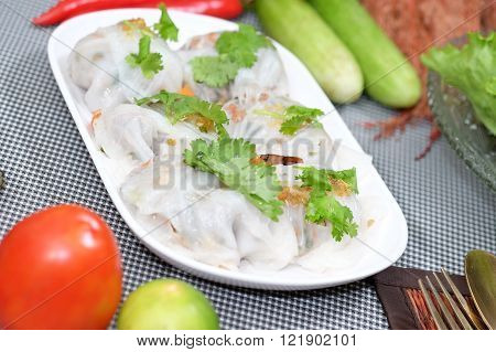 Steamed tapioca dumpling with pork and salad