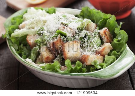 Classic caesar salad with roman lettuce, croutons, parmesan cheese and dressing