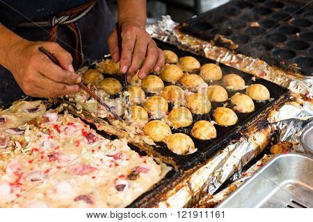 Cooking of tako yaki at stall