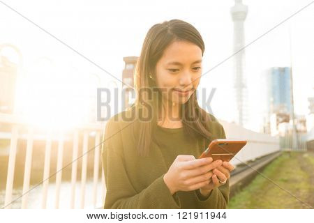 Woman use of cellphone at Tokyo city