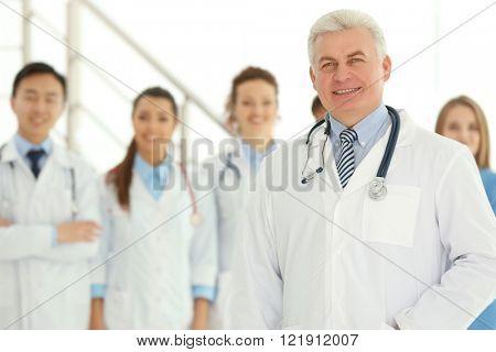 Team of smiling doctors indoors